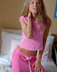 Horny chick enjoys inserting a large pink pleasure stick